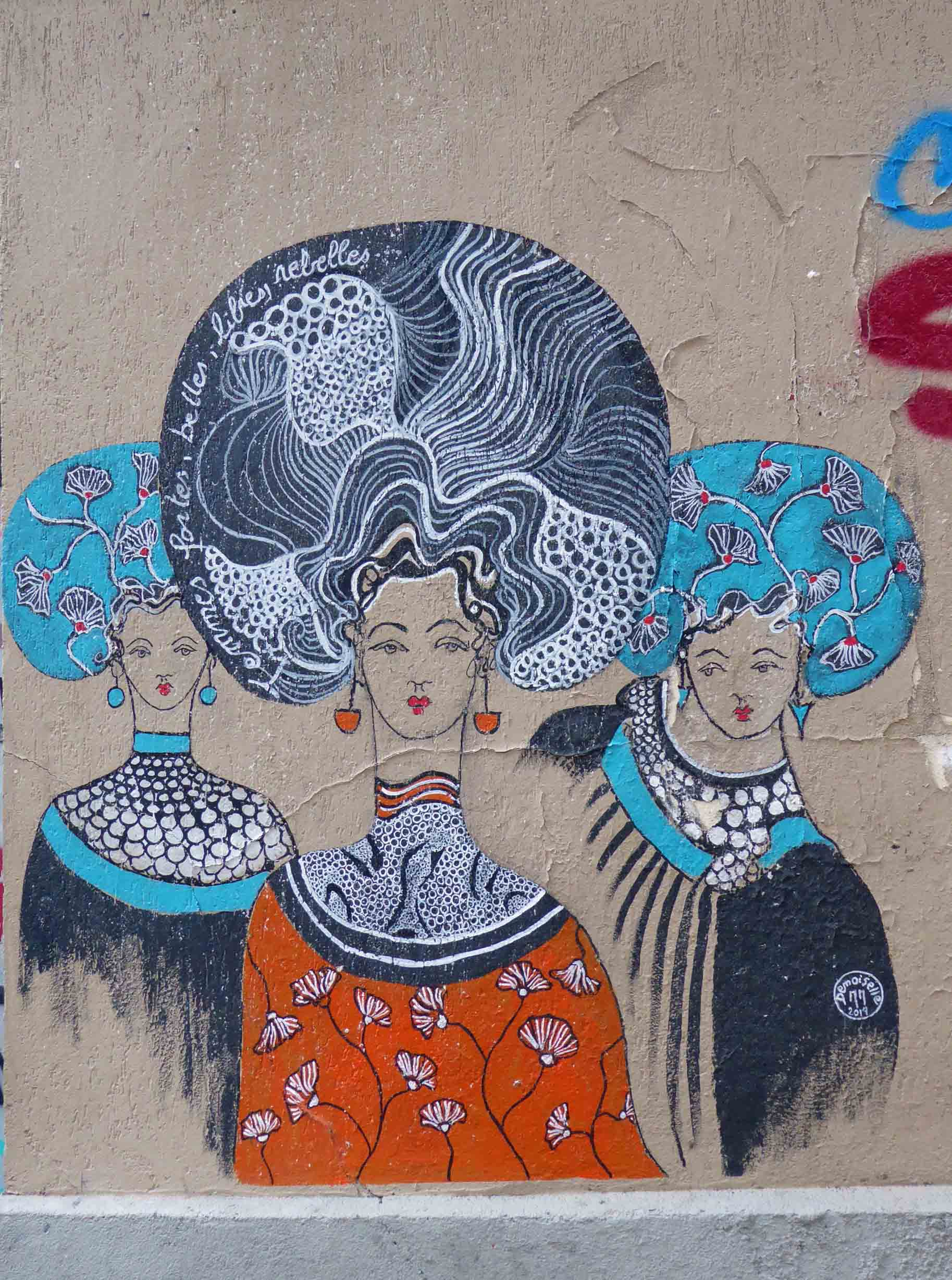 Mural of three ladies with dramatic hair