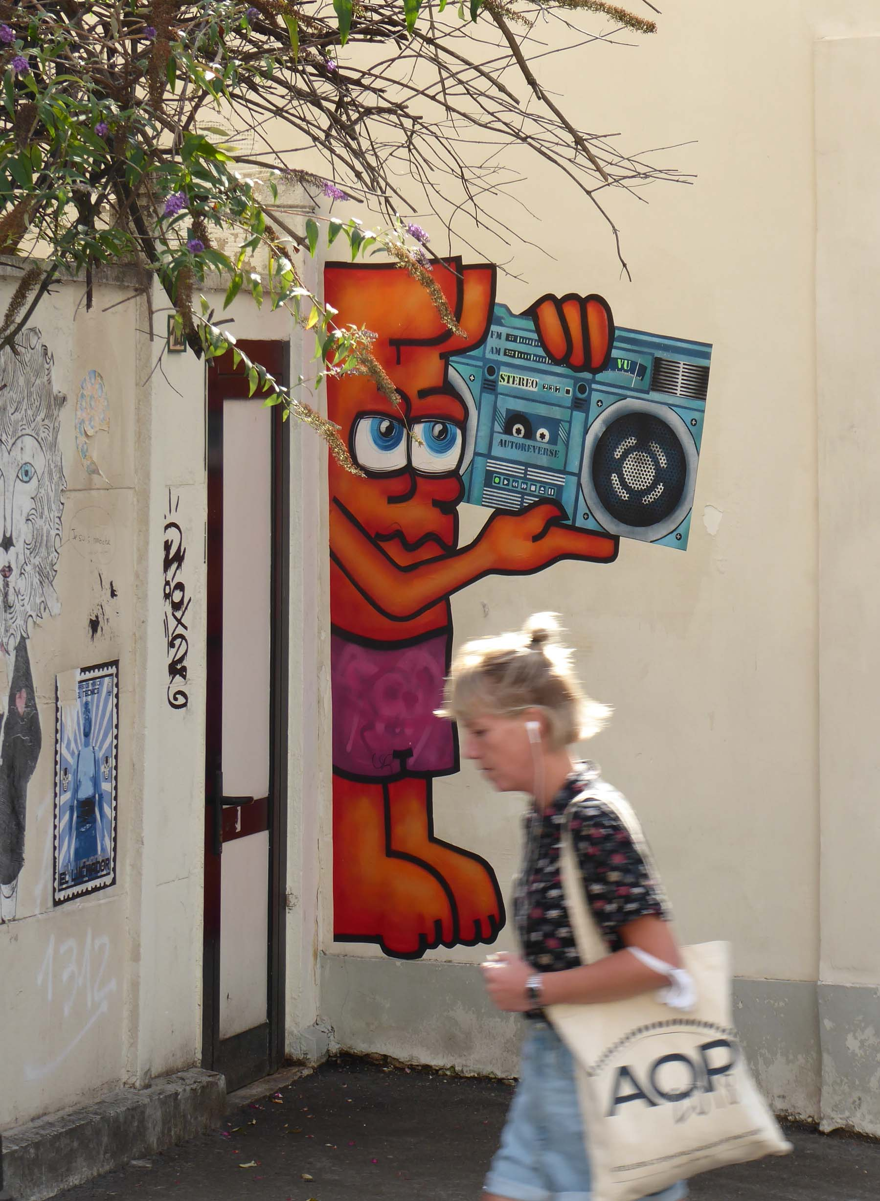 Lady passing a small mural