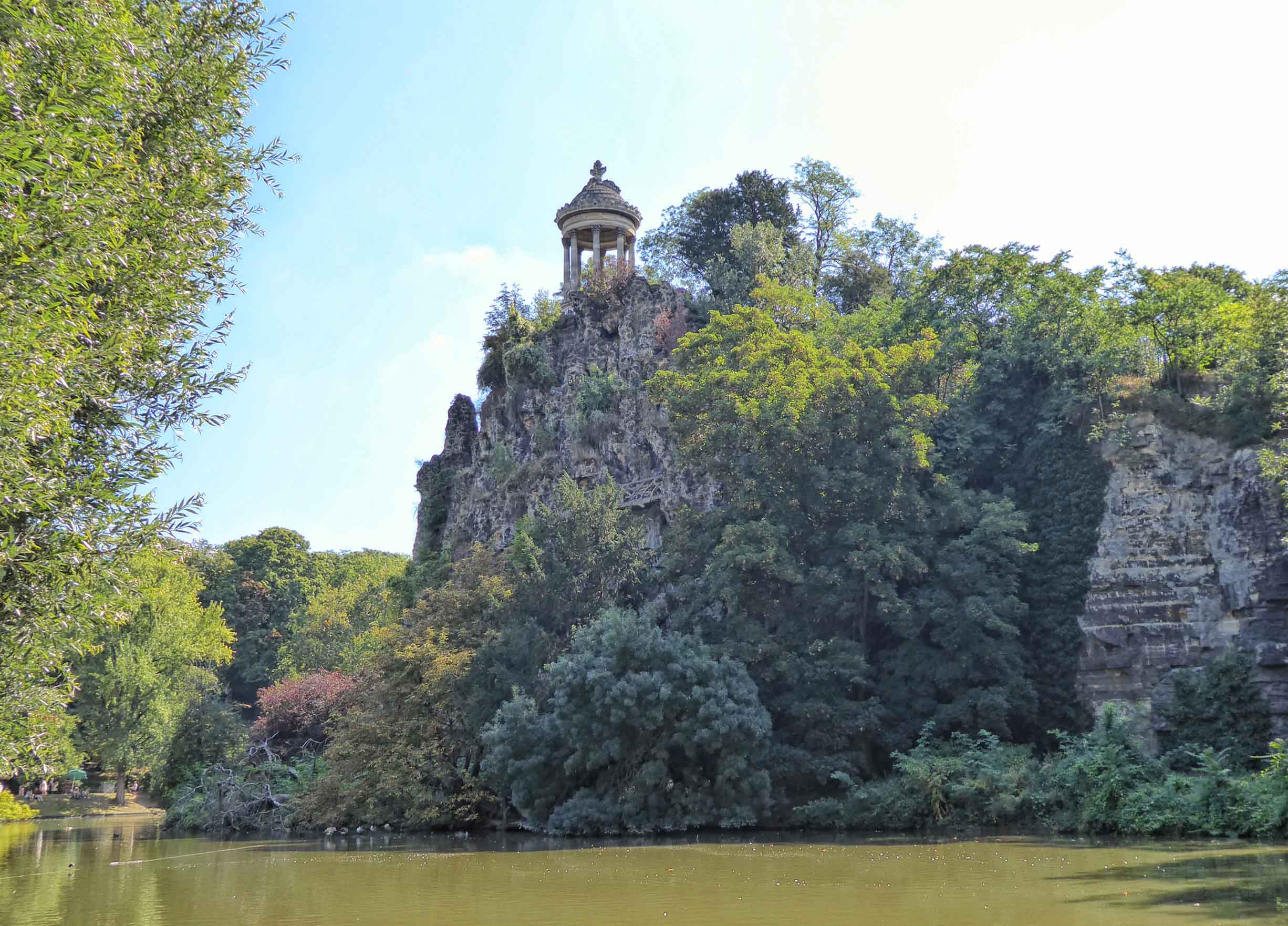 Lake with rocky islet with a small temple on top