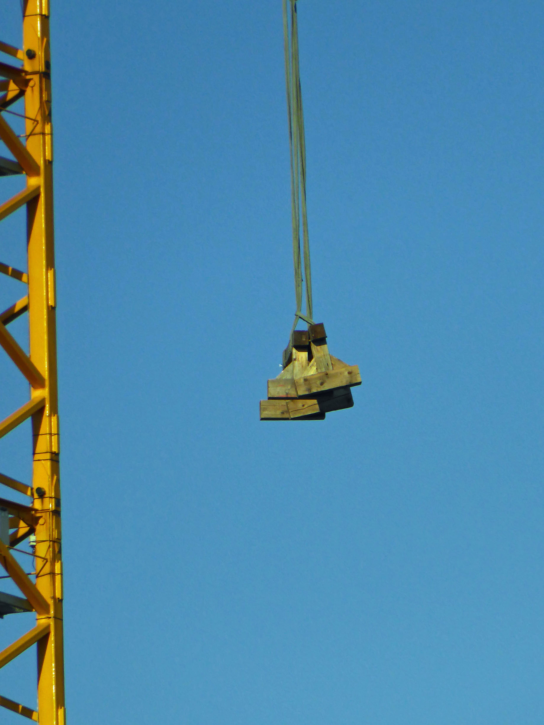 Crane with load of timber