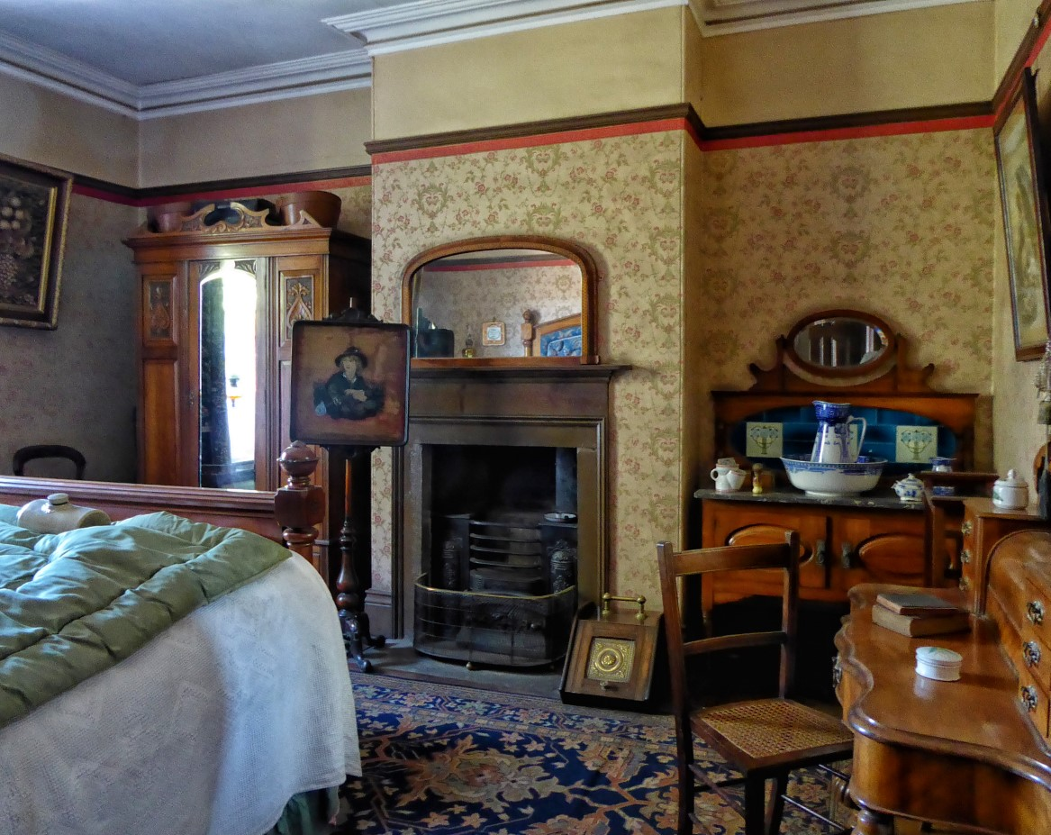 Old-fashioned bedroom with fireplace