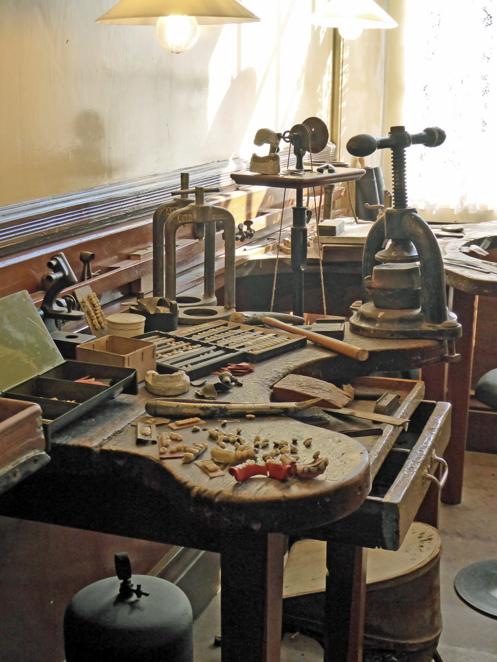 Wooden counter with teeth and tools
