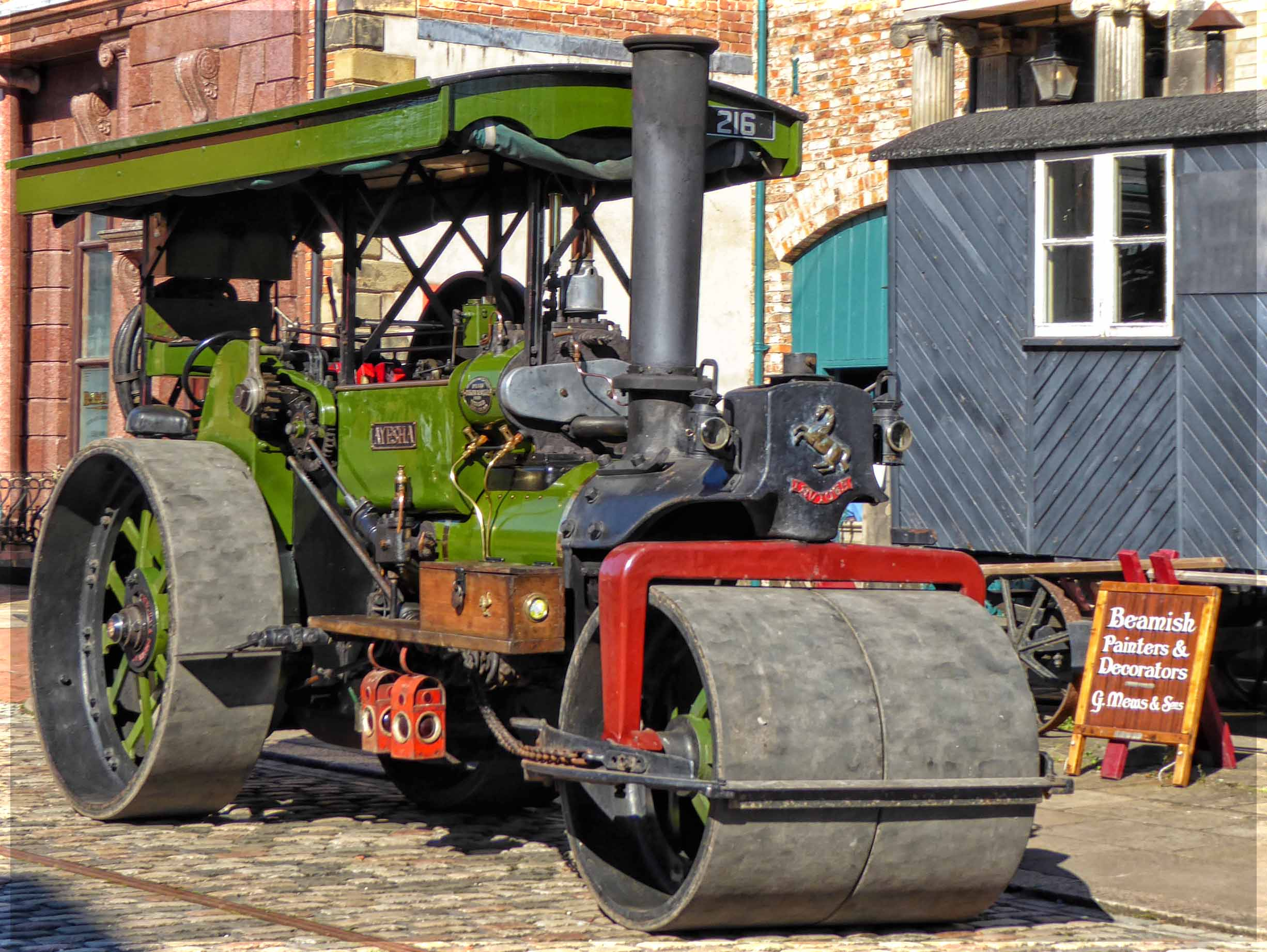 Old-fashioned green painted steam roller