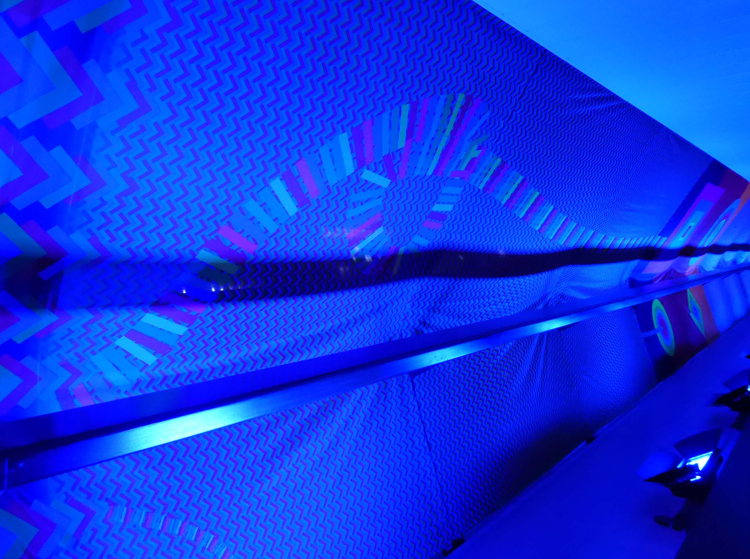 Tunnel lit with blue light
