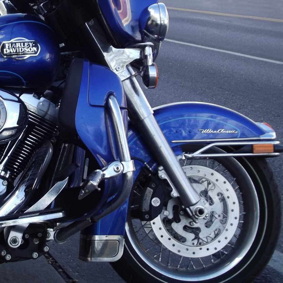 Front part of a bright blue motorbike