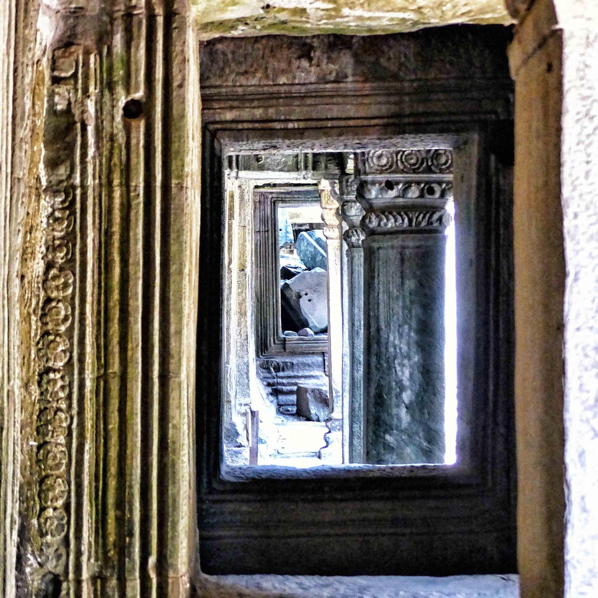 Looking through series of carved doorways