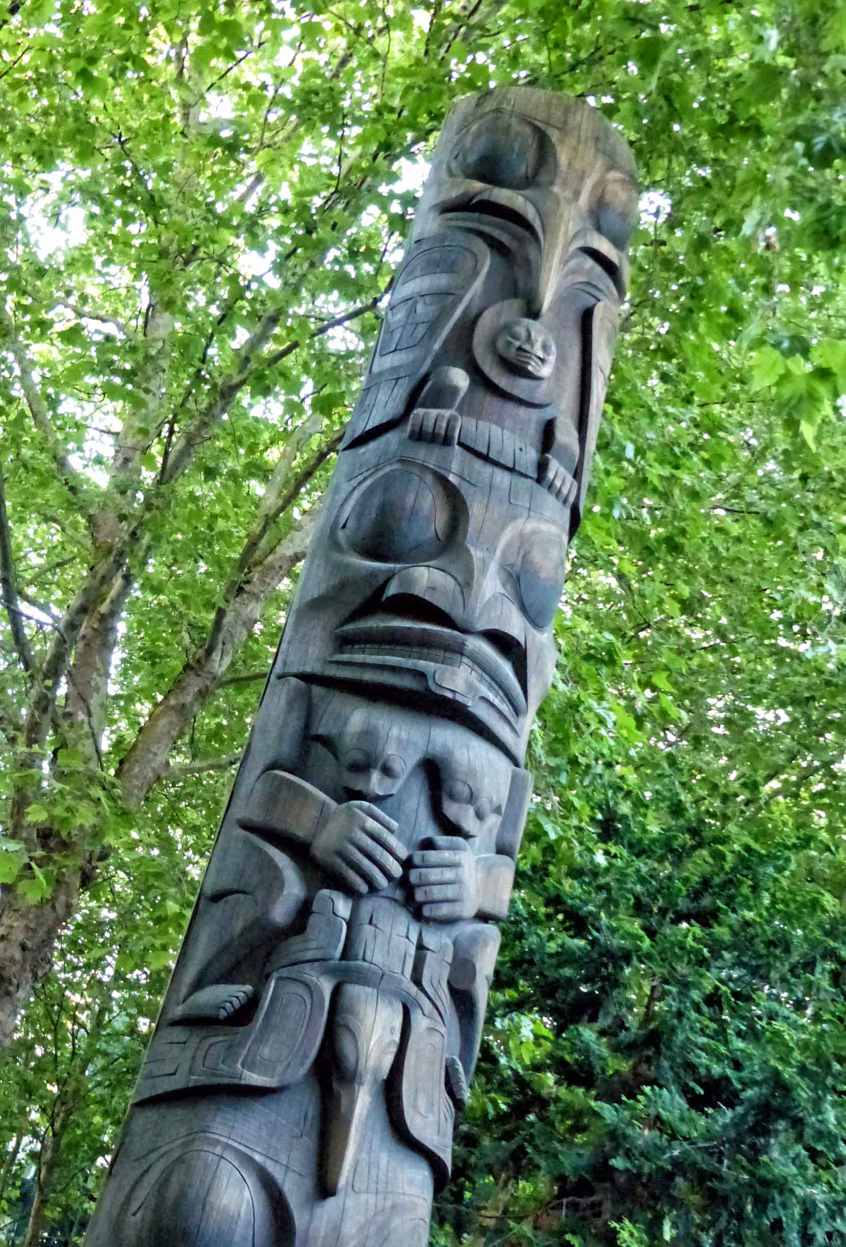 Totem pole and trees