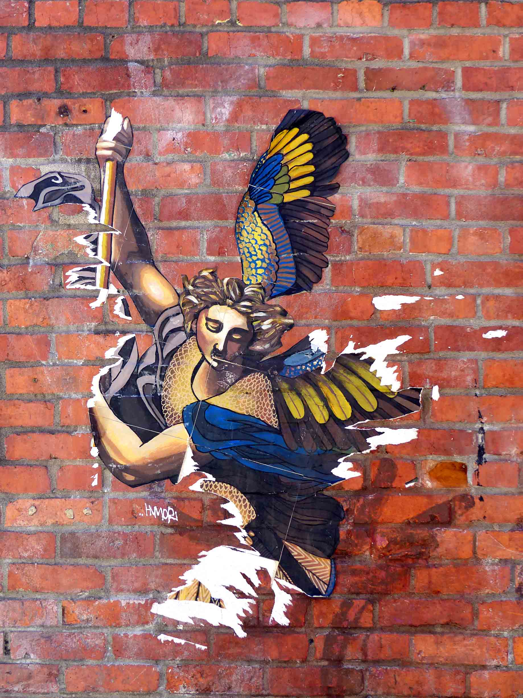 Mural of angel with blue and yellow wings