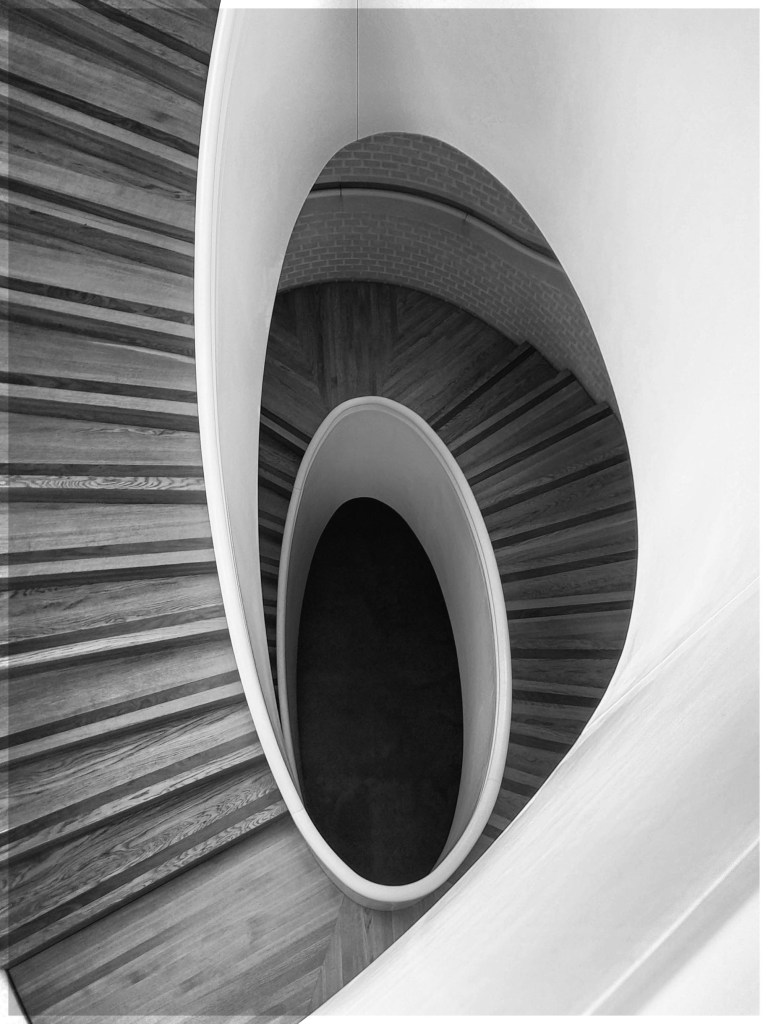 Looking down a spiral staircase, black and white