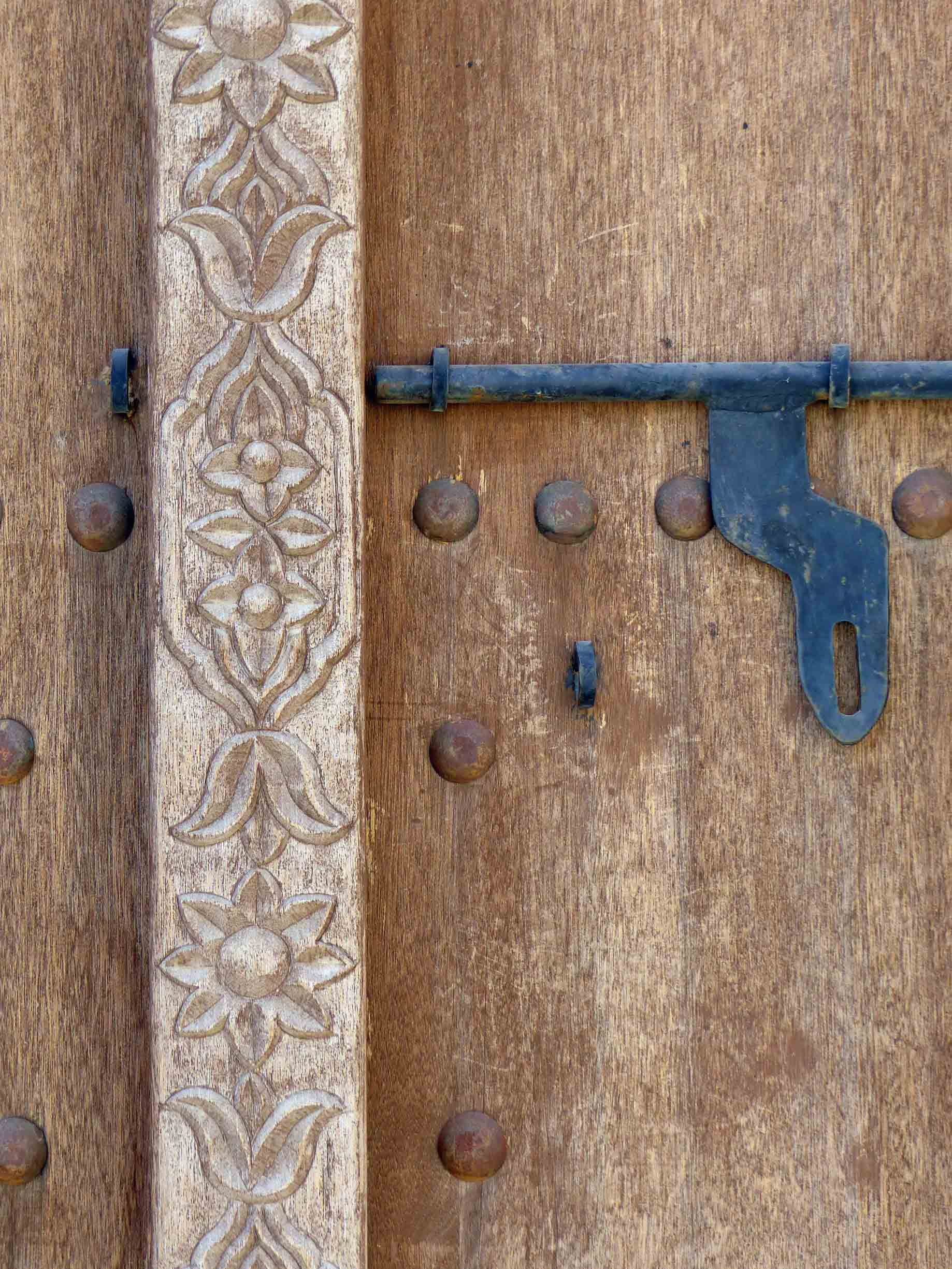 Carved wood and metal latch