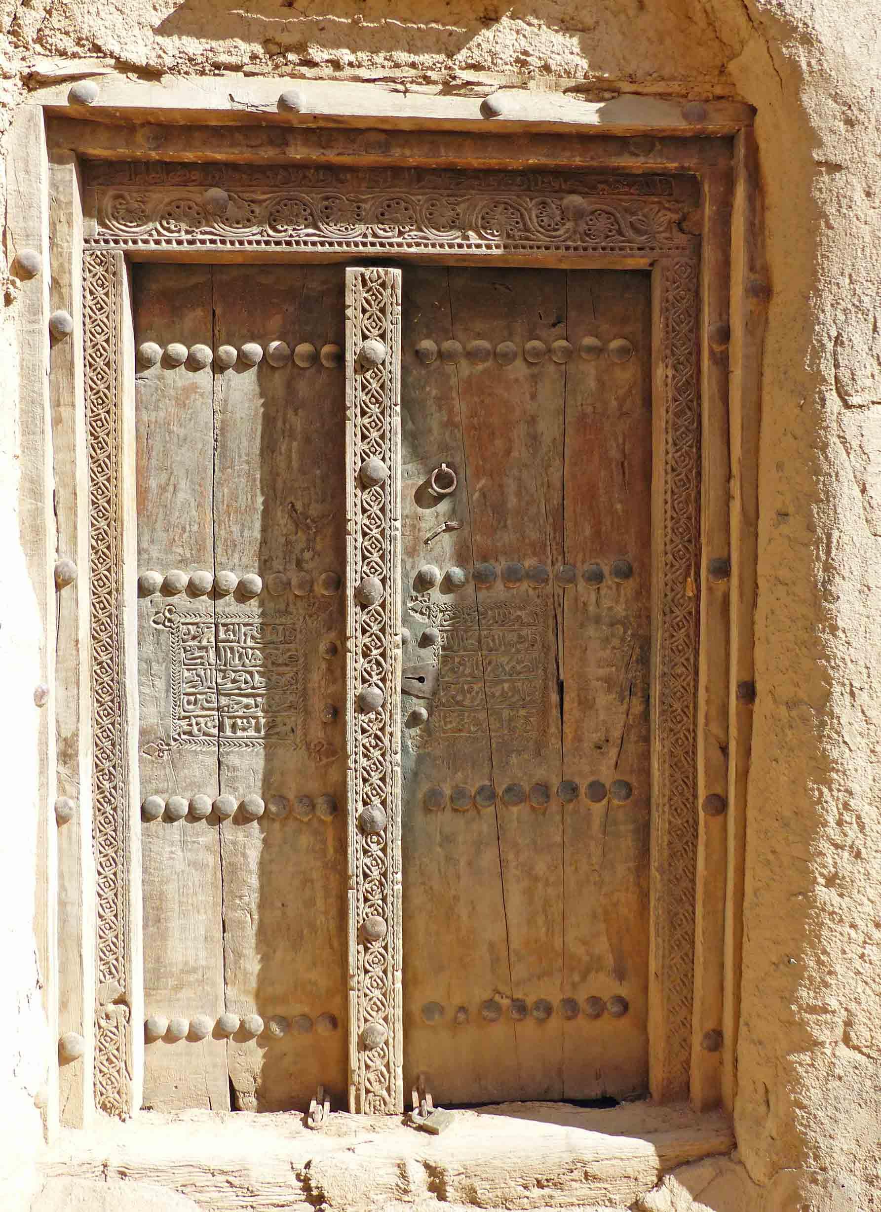 Carved wooden door and door frame