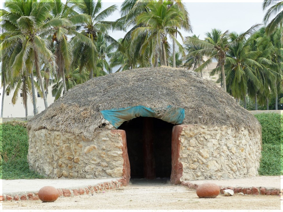 Round stone hut with grass roof