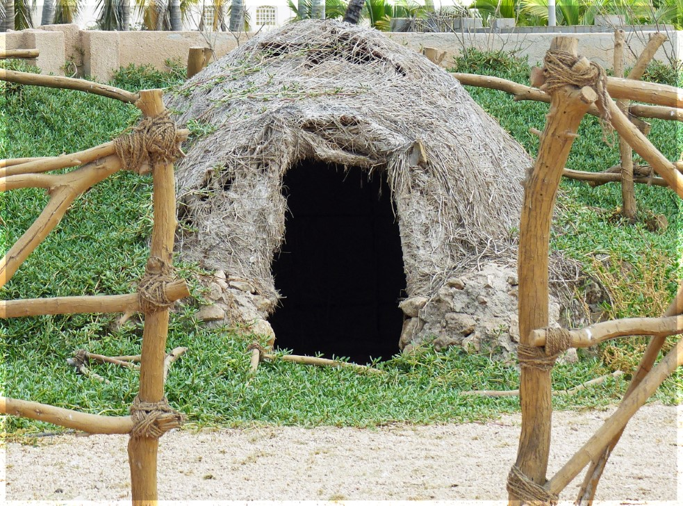 Conical hut of grass and adobe