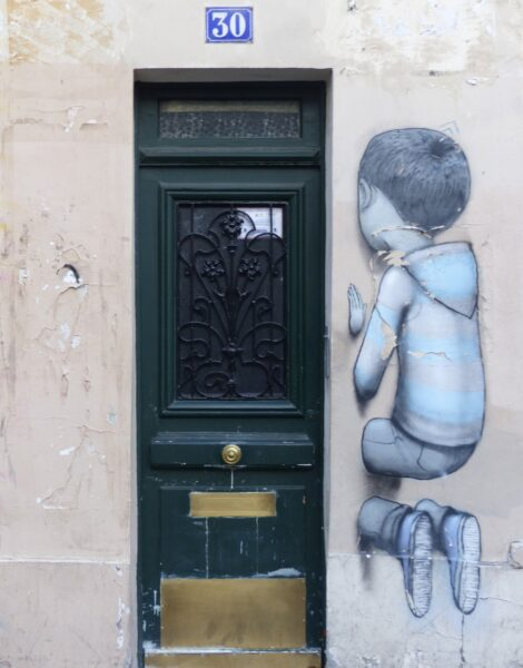 Painting of a boy kneeling by a green door