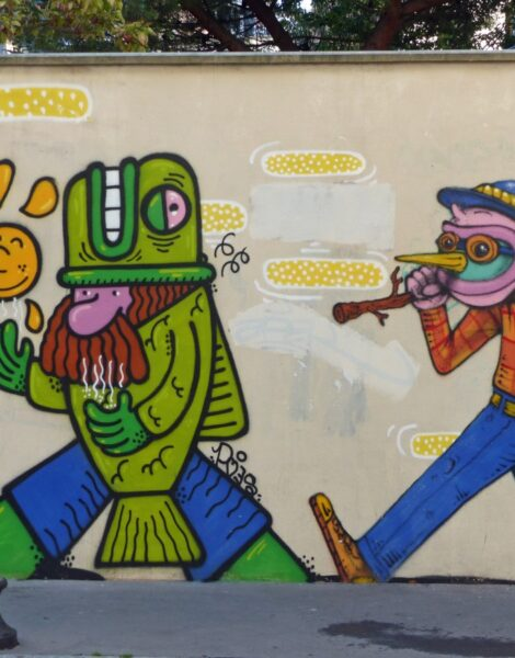 Colourful graffiti with two figures on a wall