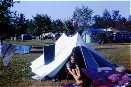 Teenage girl at the entrance to a tent