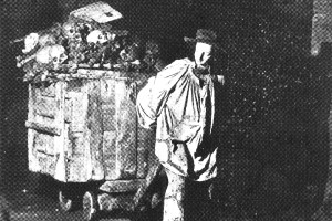Wheeling in the dead: a worker brings one of the last batches of bones into the Catacombs circa 1860