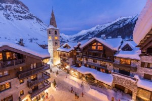 France, Savoie, Val D'Isere, view of the village and Saint Bernard de Menthon Church with a squared Lombard bell tower at dusk, massif de la Vanoise, hight Tarentaise valley
