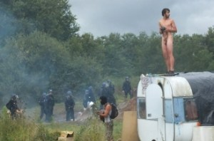 Naked aggression:  a protester braving the elements atop a caravan