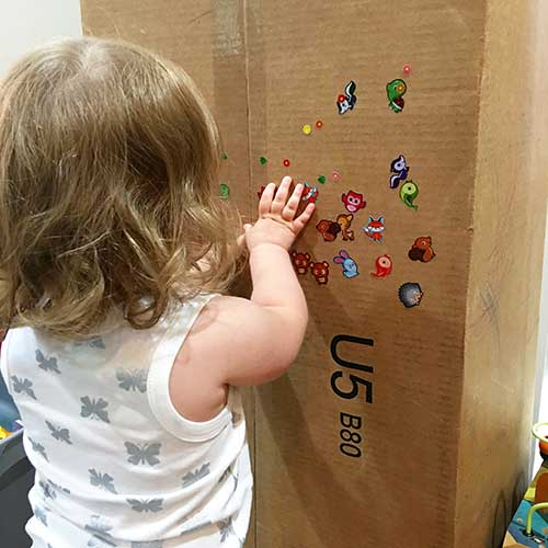 toddler playing stickers