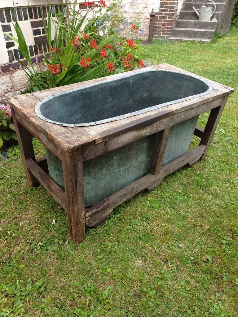 baignoire en cuivre et bois