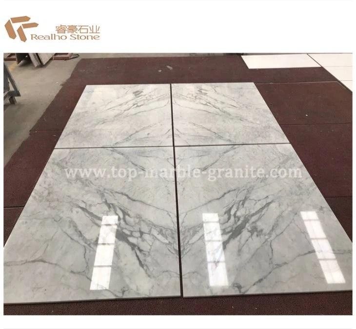 book matching staturario white marble