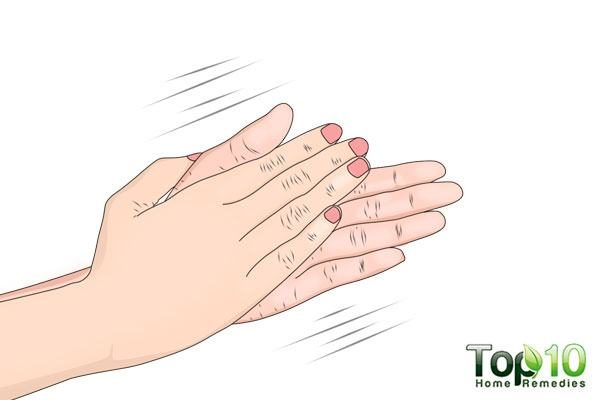 Rub your hands together to distribute the oil or serum evenly for the face massage