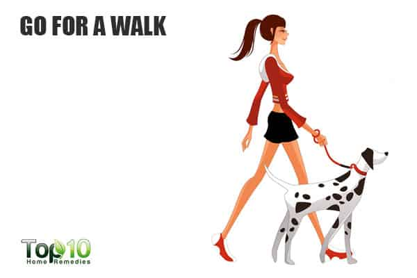 Go outside for a walk to suppress your cravings and eat less