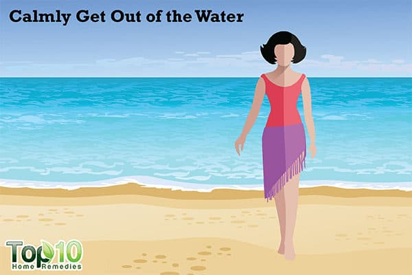 jellyfish sting first aid get out of water