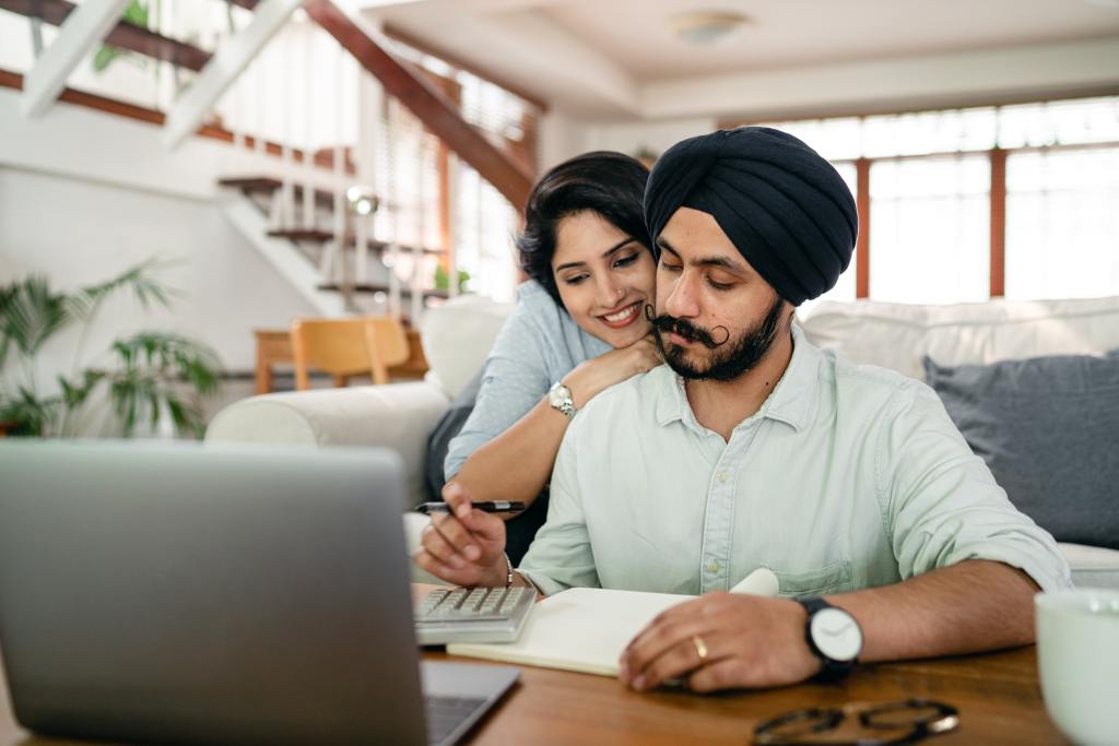 Man Working From Home with Woman