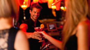 CNNPWK Bartender handing woman a cocktail
