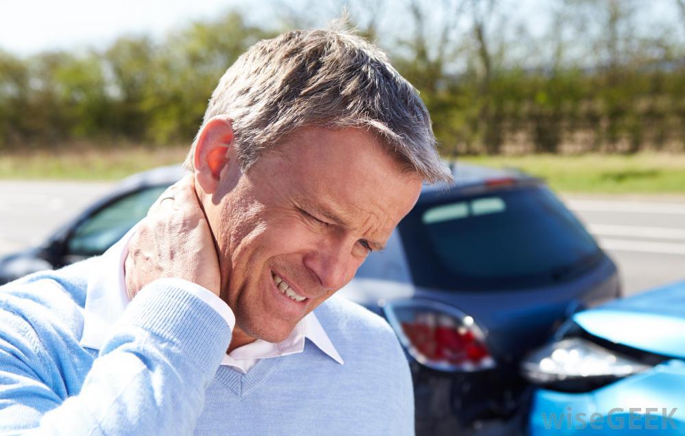 man-rubbing-neck-after-car-wreck