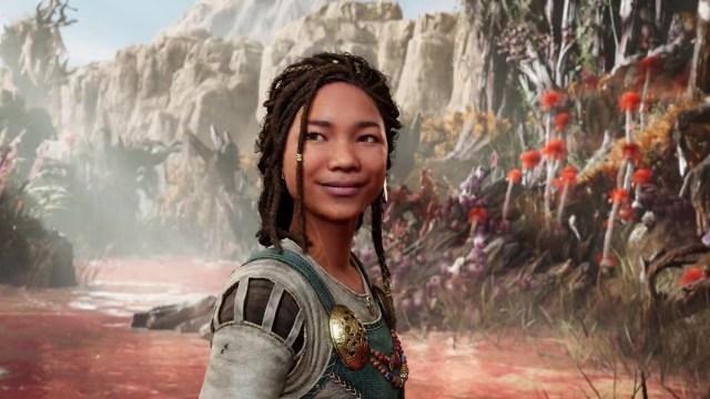 una adolescente de piel morena con rastas, Angrboda, en God of War Ragnarok