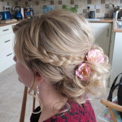 12 Low Curly Updo With Braid And Flowers