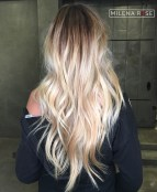 31 Layered And Tousled Blonde Vcut