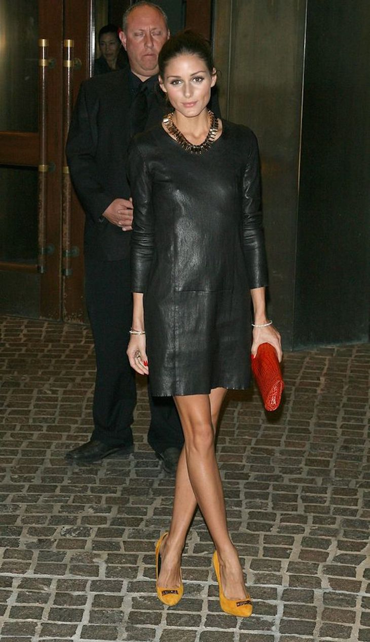leather dress and red clutch