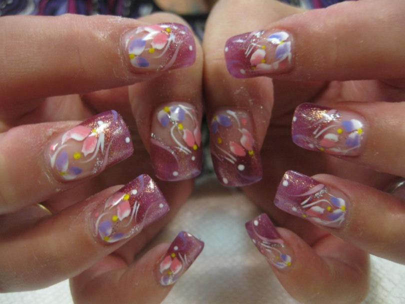Sparkling pink tips with pink/white and lavender/white flower petals and yellow and white dots with white swirls