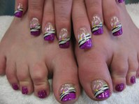 Angled bright purply/pink tip with sparkles, angled zebra band, topped with pink petal flower and curved white dots.