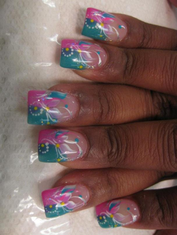 Aqua/Bright pink half/half tip, circle of white dots topped with light pink/blue petals, white/pink swirls and blue dot.