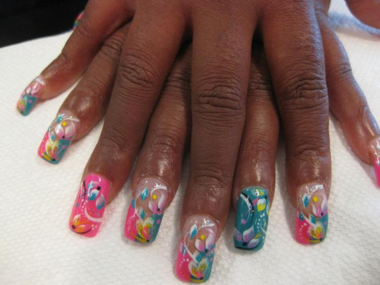 Aqua/bright pink half/half tip or full color nail with yellow/pink/blue flower petls and white/yellow swirls and black/yellow/white dots.