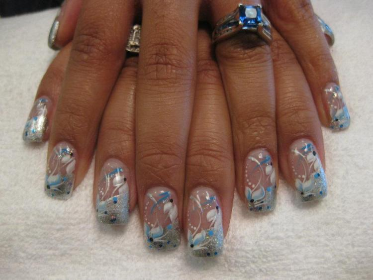 Angled sparkling silver tip with white/blue lilies, blue/black/white dots, blue/white/sparkly swirls.