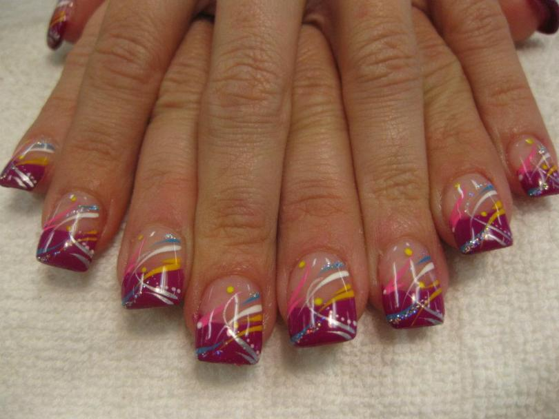 Pink tip topped with flesh colored nail, blue/silver/yellow/white/pink swirls, yellow/white dots and sparkles.