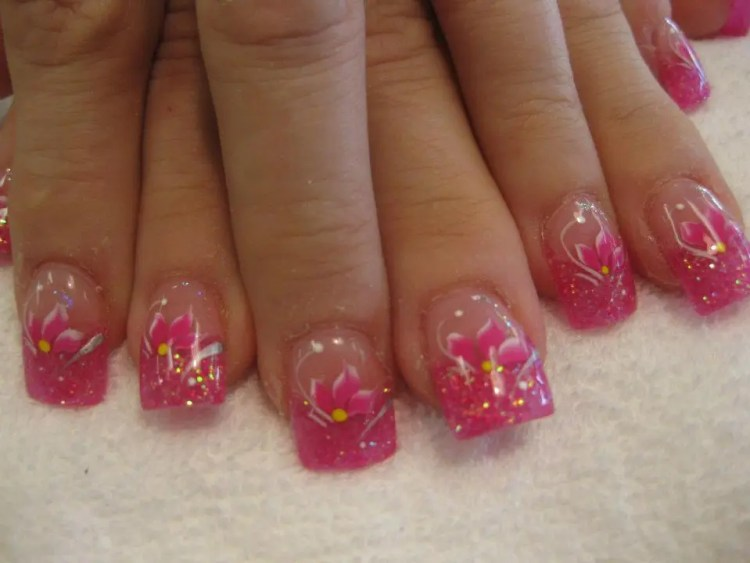 Sparkling pink tip topped with bright pink/white tipped lily, white/sparkly swirls, and white/yellow dots.