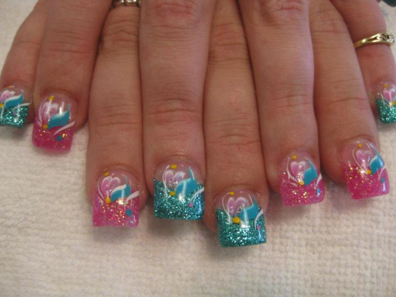 Sparkling aqua or bright pink tip topped, pink/white lily petals and ocean blue swish, white swirls, yellow/pink or blue dots.