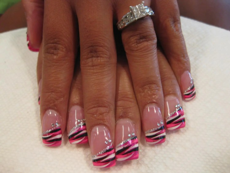 Angled Bright pink/pink/white/black striped swirls topped with angled sparkling band and two diamond glue-ons.