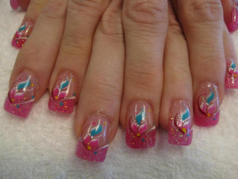 Sparkling bright pink tip topped with bright pink/blue/white flower petals, white/red/sparkly swirls, and blue/yellow dots.