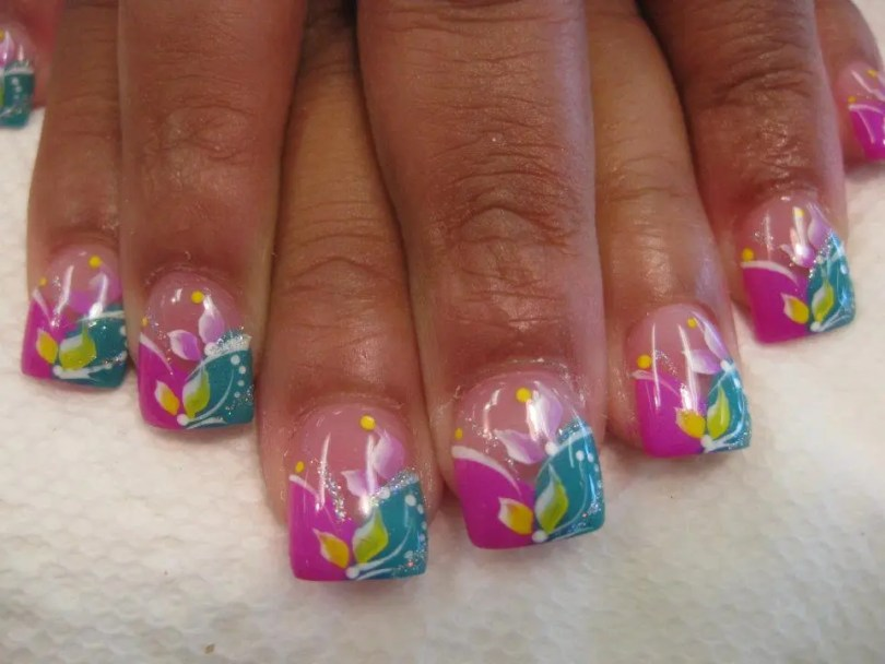 Curved aqua/curved bright pink half/half tip with yellow/pink/white lily petals, white/sparkly swirls, white/yellow dots.
