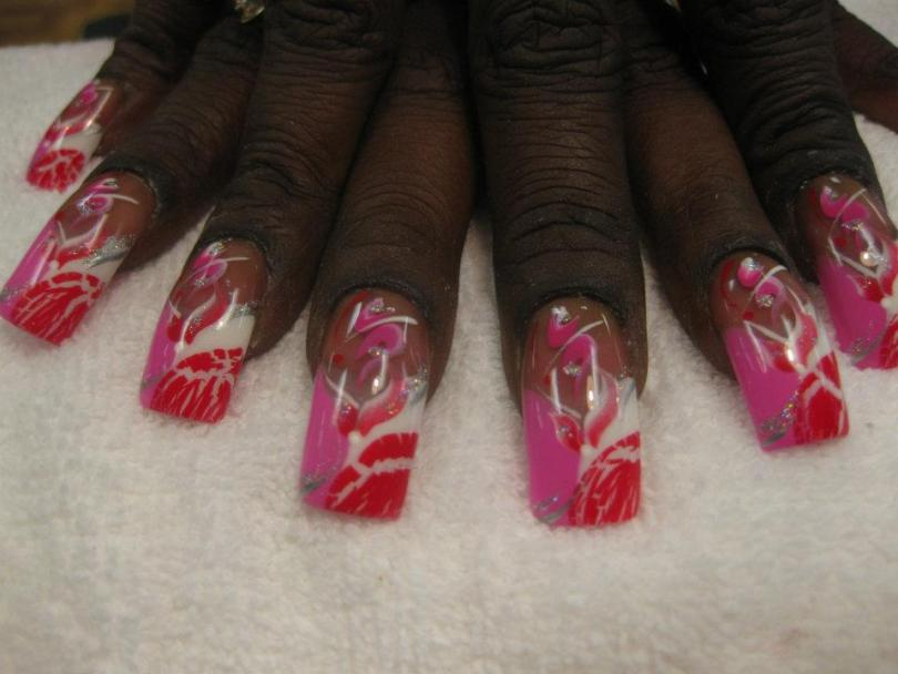 Half bright pink/half white tip with red lipstick kiss over white, sparkly swirl over pink, pink/white/sparkly swirls, red dot.
