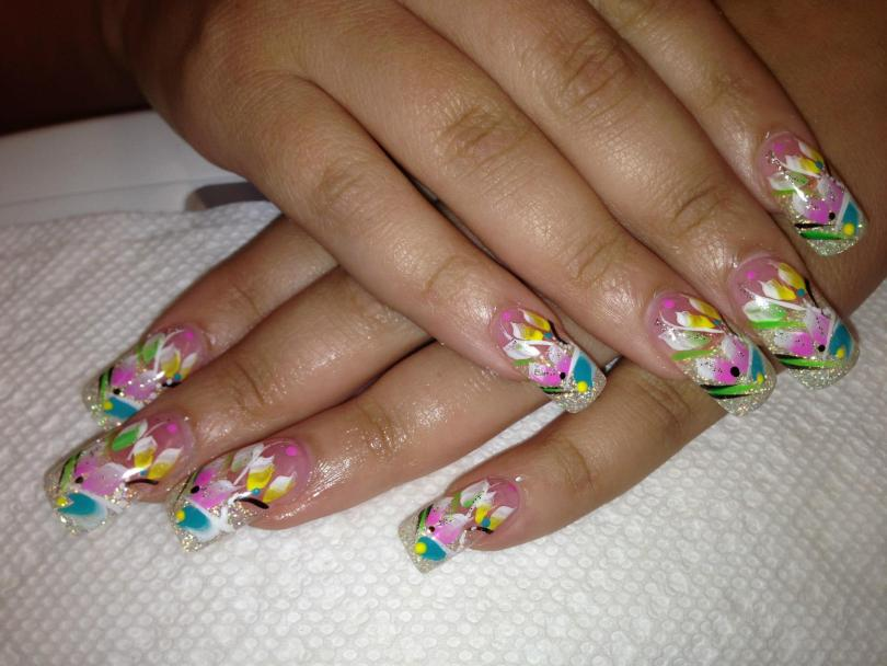Sparkling diamond tip with light green/pink/yellow/blue lily petals, black/white swirls, pink/yellow/blue dots.