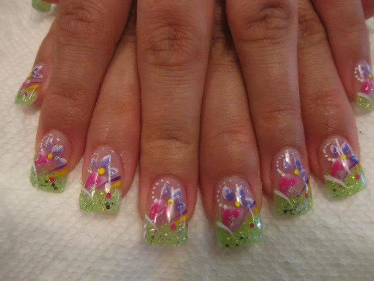 Sparkling light green tip with white/purple swirls, pink heart, lavender/white lily, white/yellow/red/black dots.